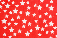 Coupon de tissu en coton imprimé étoiles blanches/fond rouge - 43 x 53 cm - Coupons de tissus - 10doigts.fr