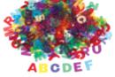 Lettres en plastique translucide - 260 pièces - Décorations à coller - 10doigts.fr